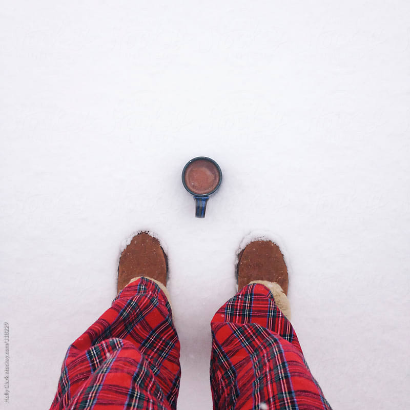 Cup of coco and red flannel pants by Holly Clark for Stocksy United