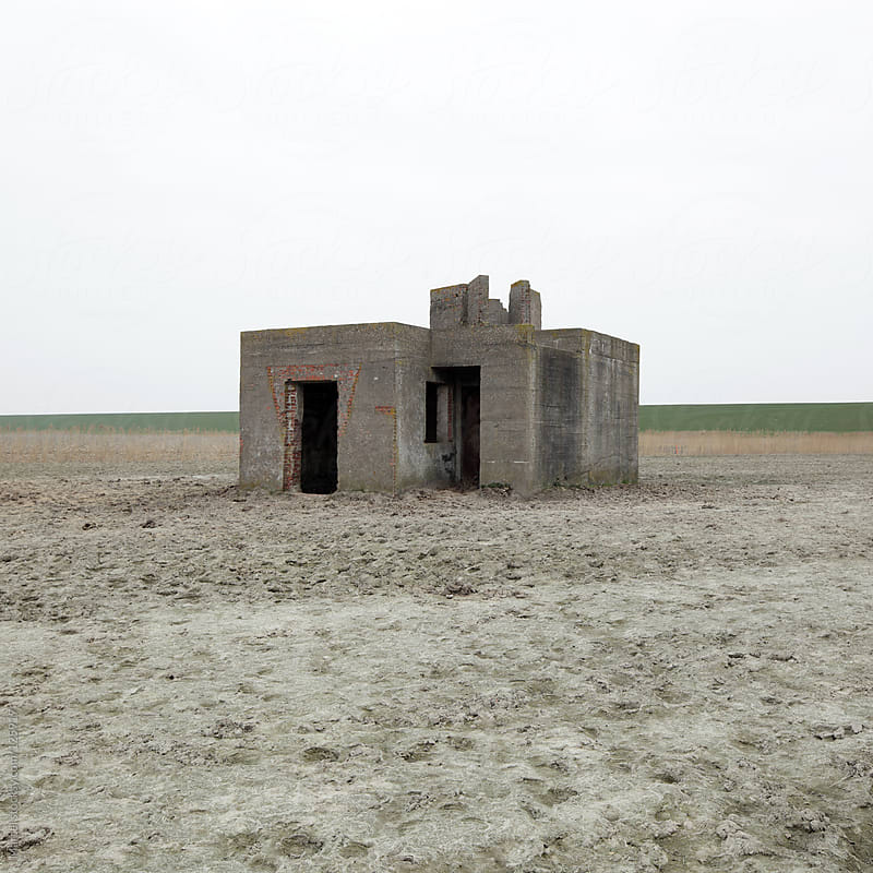 Old bunker in a field by Marcel for Stocksy United