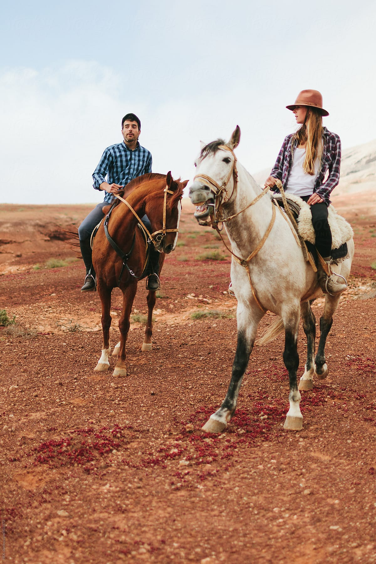 Young Couple Riding Horses In The Desert By Mattia Stocksy United