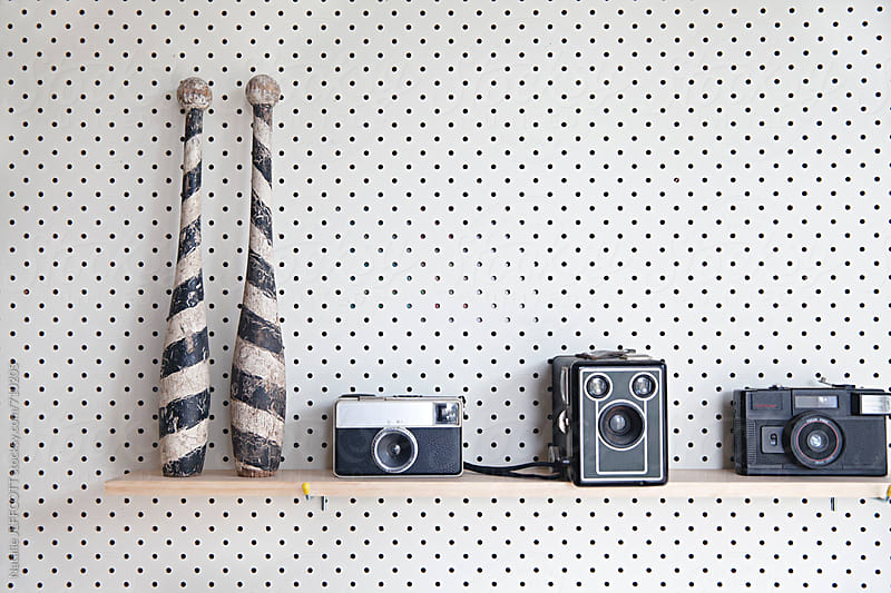 Pegboard / Perforated board with close up of shelves in a studio office by Natalie JEFFCOTT for Stocksy United