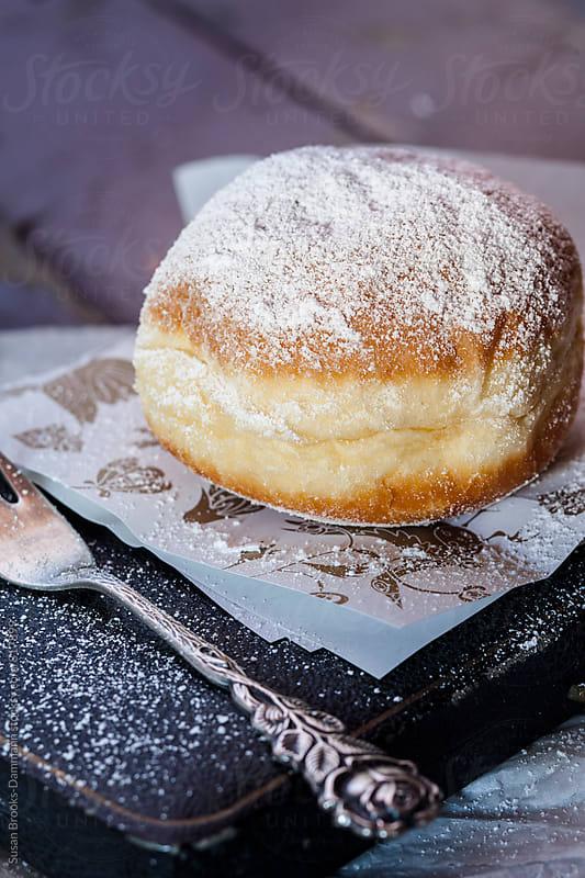 Bismarck doughnut by Susan Brooks-Dammann for Stocksy United