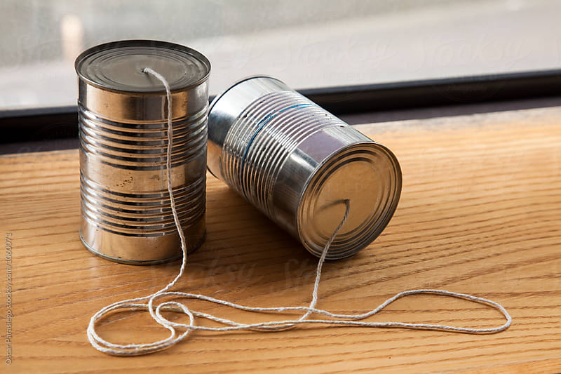 Tin Can Phone by Oscar Parasiego for Stocksy United