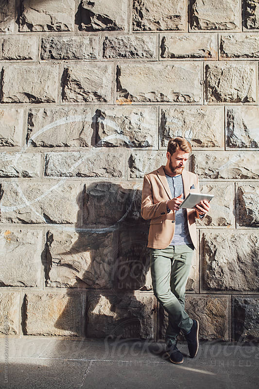 Young Businessman Using a Tablet Outdoors by Lumina for Stocksy United