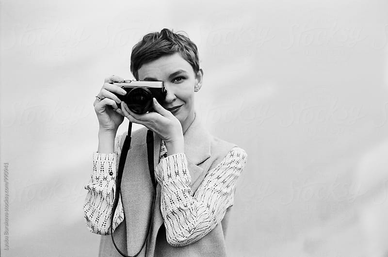 Woman taking a photo by Lyuba Burakova for Stocksy United