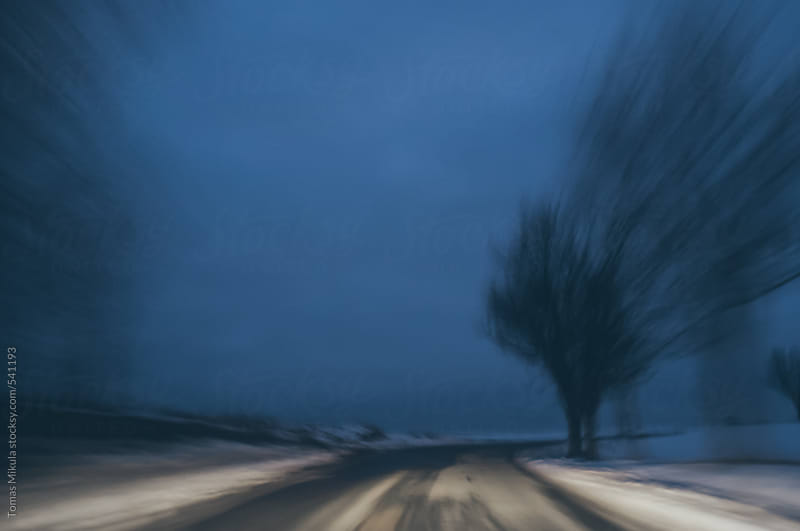 Blurred image from car by Tomas Mikula for Stocksy United