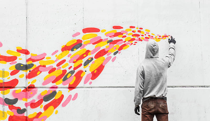 Street artist drawing with spraycan on wall by Audrey Shtecinjo for Stocksy United
