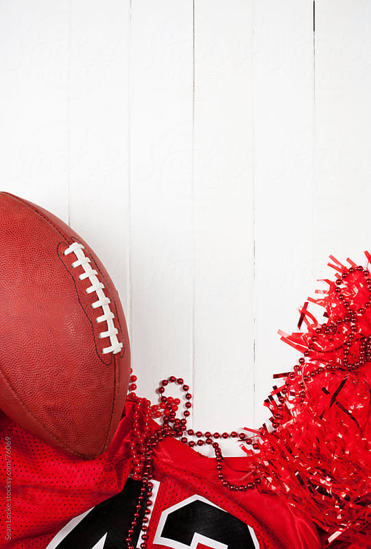 Football: Ball with Football Jersey Background by Sean Locke for Stocksy United