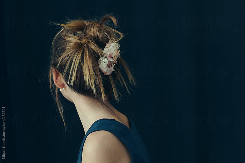 Young girl with flower clip by Miquel Llonch for Stocksy United