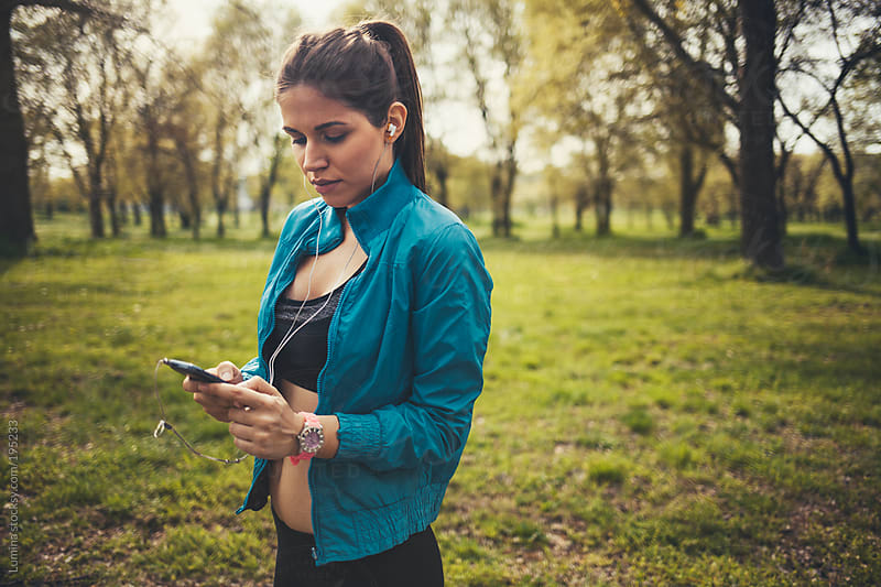 Woman Listening to Music While Jogging by Lumina for Stocksy United