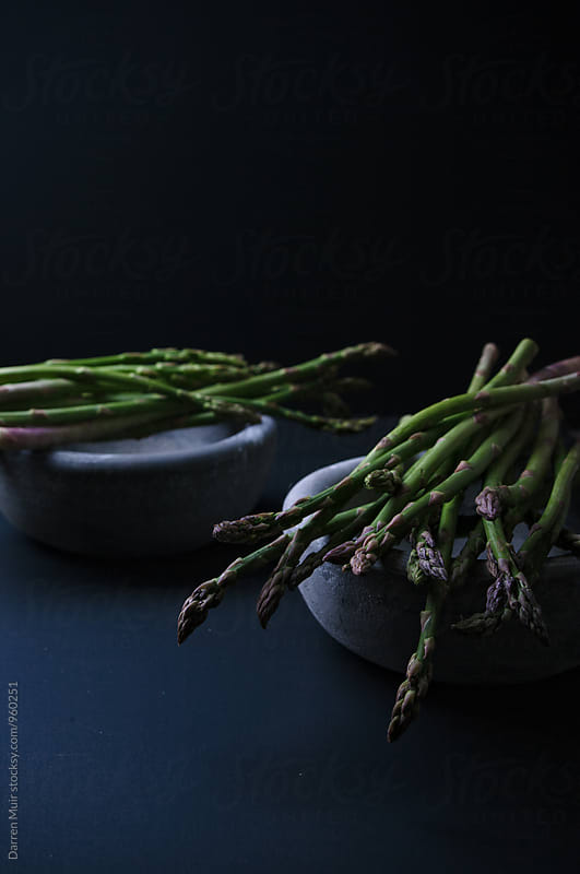 Bundles of asparagus. by Darren Muir for Stocksy United