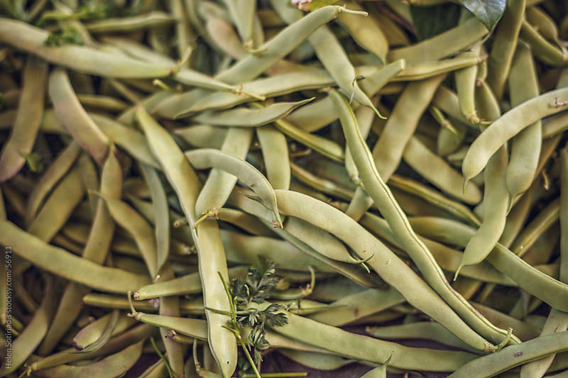 String beans at the local market by Helen Sotiriadis for Stocksy United