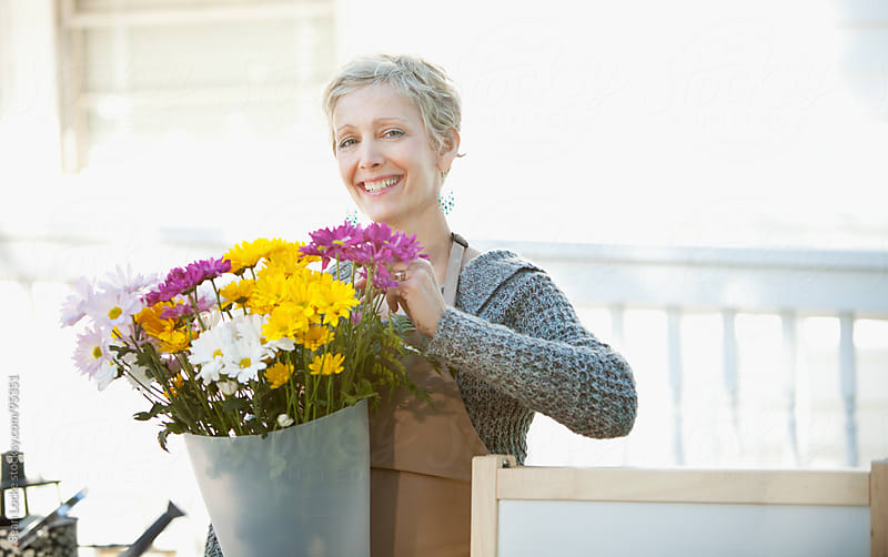Shop: Happy Florist Working with Daisies by Sean Locke for Stocksy United