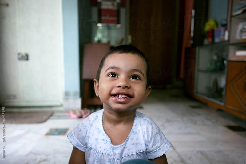 Cute baby girl smiling by Saptak Ganguly for Stocksy United
