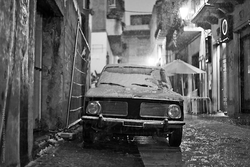 old car under snow by Tommaso Tuzj for Stocksy United