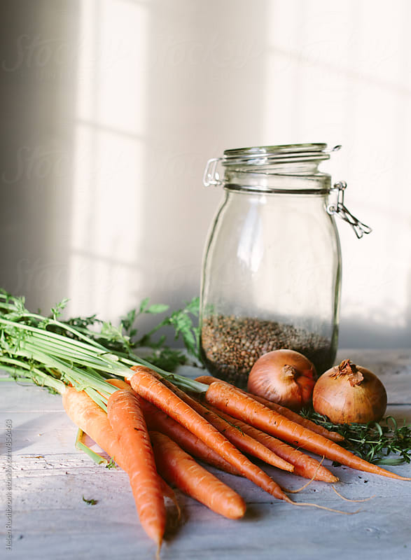 Carrots, onions and lentils. by Helen Rushbrook for Stocksy United
