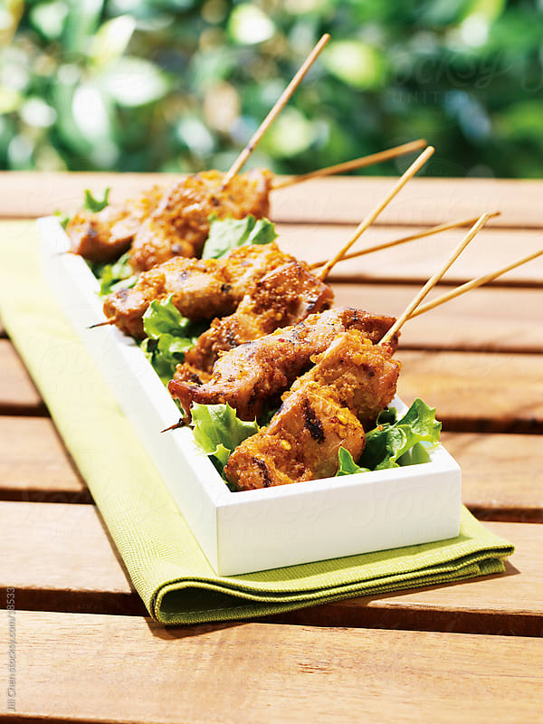 Coconut Chicken Kebabs by Jill Chen for Stocksy United