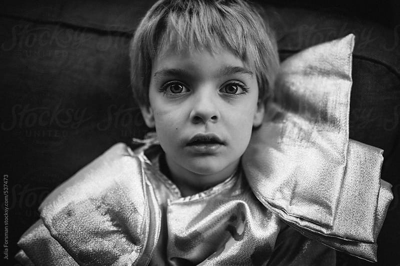 Boy in silver costume. by Julia Forsman for Stocksy United