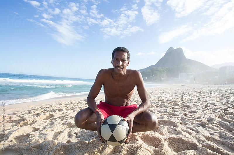Brazilian man on Ipanema beach. Rio. Brazil. by Hugh Sitton for Stocksy United