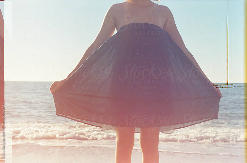 A young beautiful woman on a beach by Anna Malgina for Stocksy United