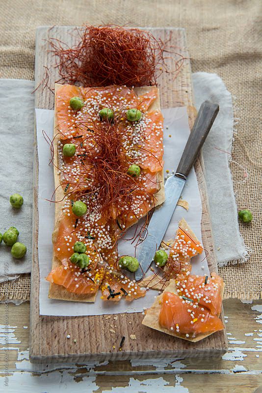 Salmon gravlax toast with wasabi peas by Marta Muñoz-Calero Calderon for Stocksy United