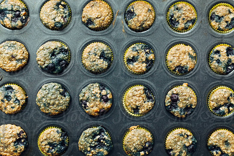 Blueberry muffins in a pan from above by Gabriel (Gabi) Bucataru for Stocksy United