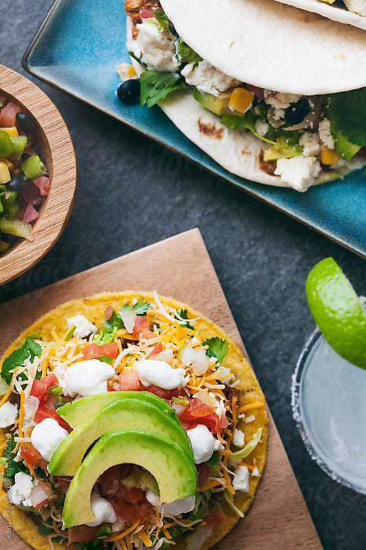 Tacos: Focus On Tostada With Soft Tacos And Salsa by Sean Locke for Stocksy United