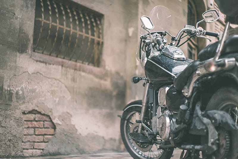 Motorcycle parked on the street. by Eva Plevier for Stocksy United