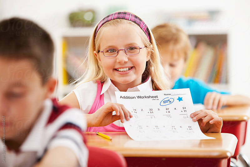 Classroom: Girl Shows Off Great Grades by Sean Locke for Stocksy United