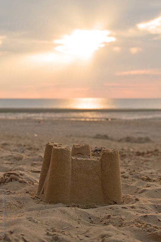 Sandcastle on the Beach at Sunset by Kirsty Begg for Stocksy United