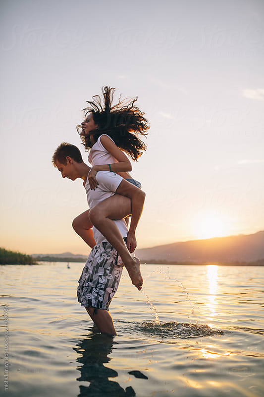Young couple having fun by michela ravasio for Stocksy United