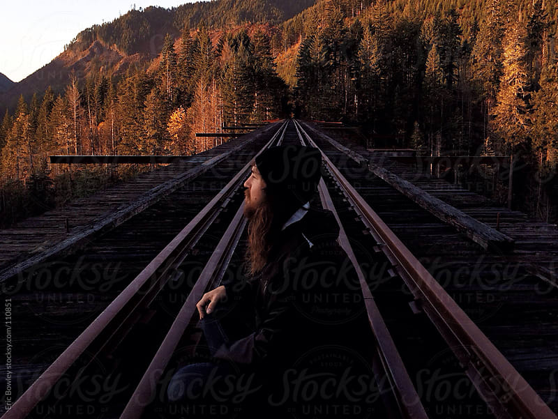 Man Sitting On Steel Bridge At Dawn by Eric Bowley for Stocksy United