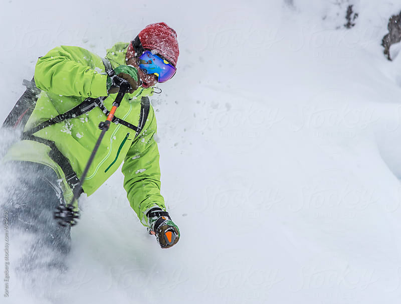 Mans skiing powder snow by Soren Egeberg for Stocksy United
