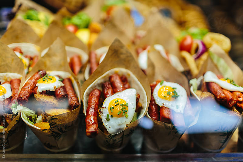 Homemade sausage & egg / breakfast at a farmers' market in Spain by Kristen Curette Hines for Stocksy United