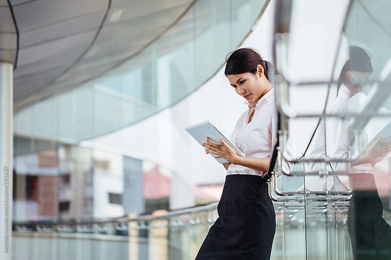 Businesswoman with her digital tablet by michela ravasio for Stocksy United
