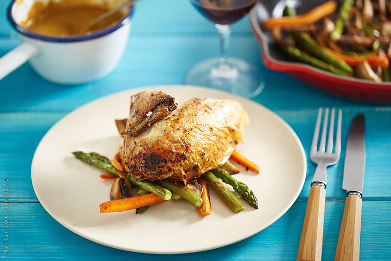 Beer can chicken with vegetables by Martí Sans for Stocksy United