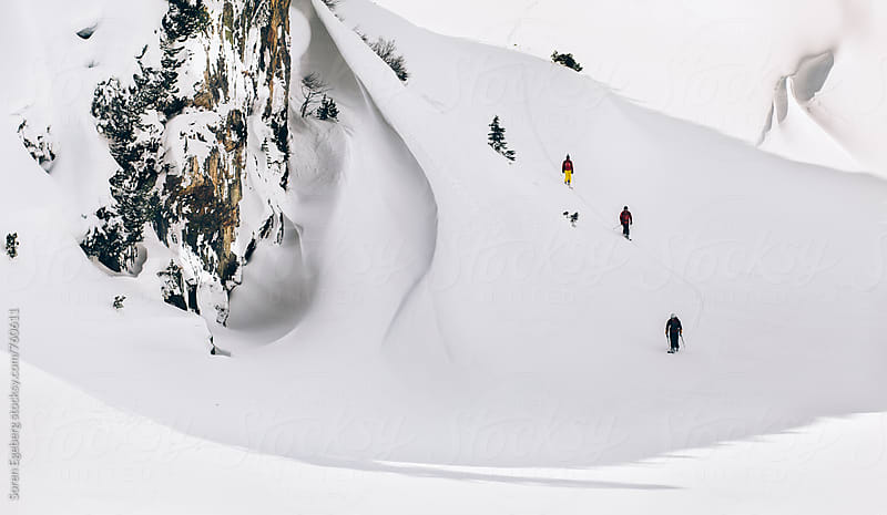 Group of friends skiing in the mountains of Austria by Søren Egeberg Photography for Stocksy United