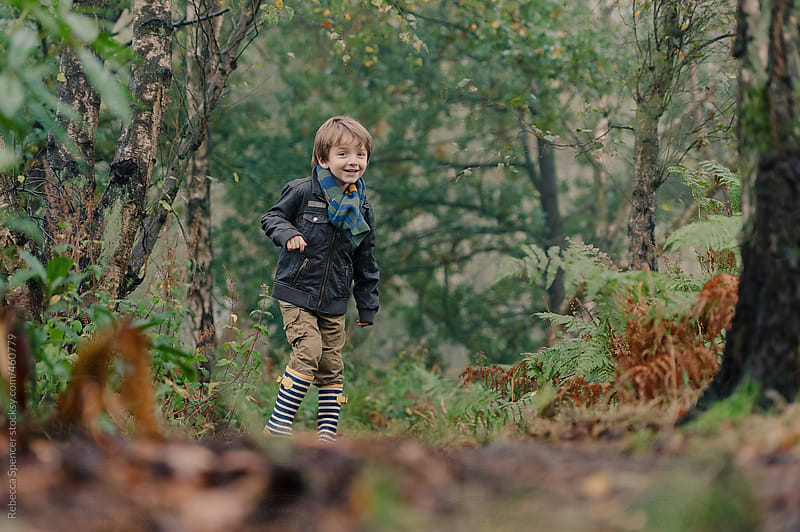 Woodland hide and seek is fun by Rebecca Spencer for Stocksy United