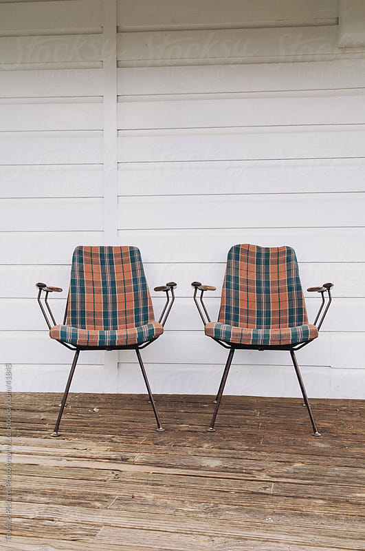 Two chairs on the deck of a house, New Zealand. by Thomas Pickard for Stocksy United