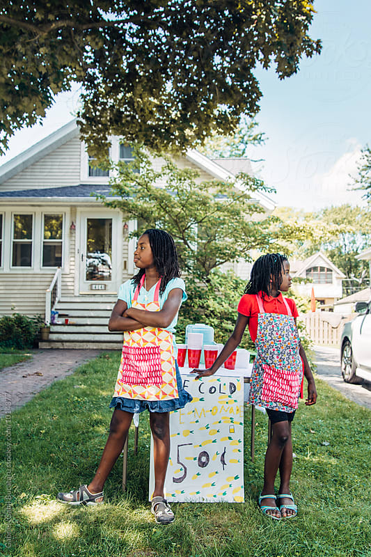 Two black girls waiting for customers by their lemonade stand by Gabriel (Gabi) Bucataru for Stocksy United
