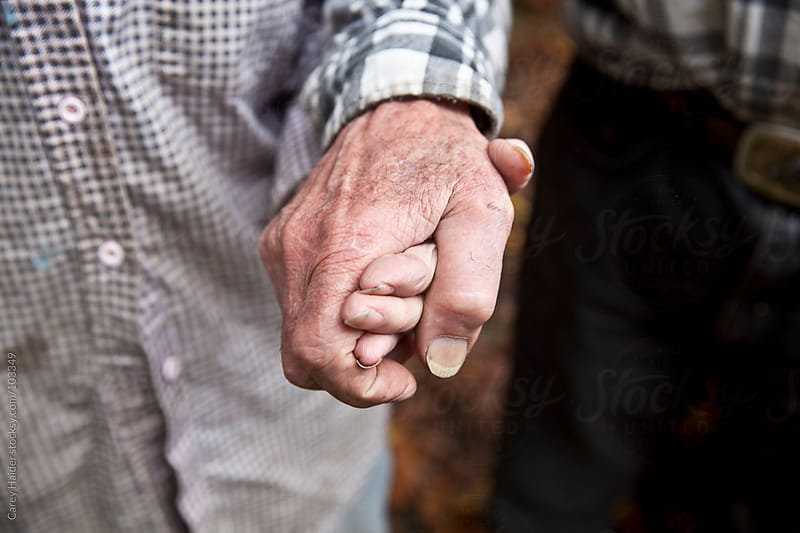 A Eldery Couple In Love Holding Hands by Carey Haider for Stocksy United