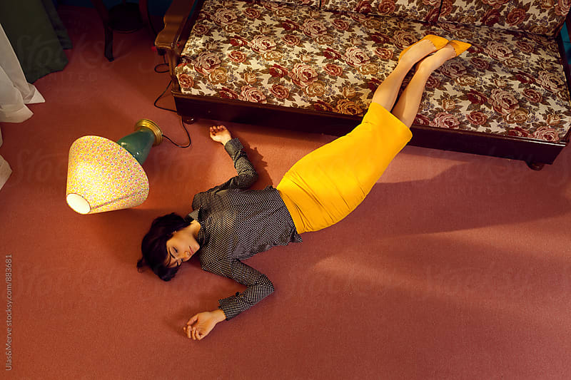 depressed young woman lies down on the floor by Ulaş and Merve for Stocksy United