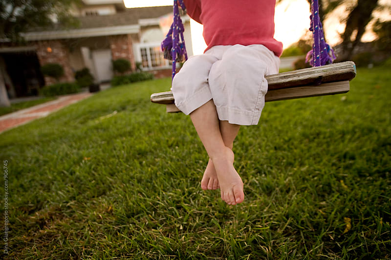 Child On Homemade Wooden Swing by Dina Giangregorio for Stocksy United