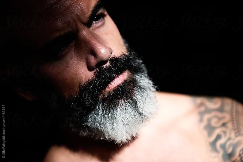 portrait of Handsome, bearded and tattooed man by Guille Faingold for Stocksy United
