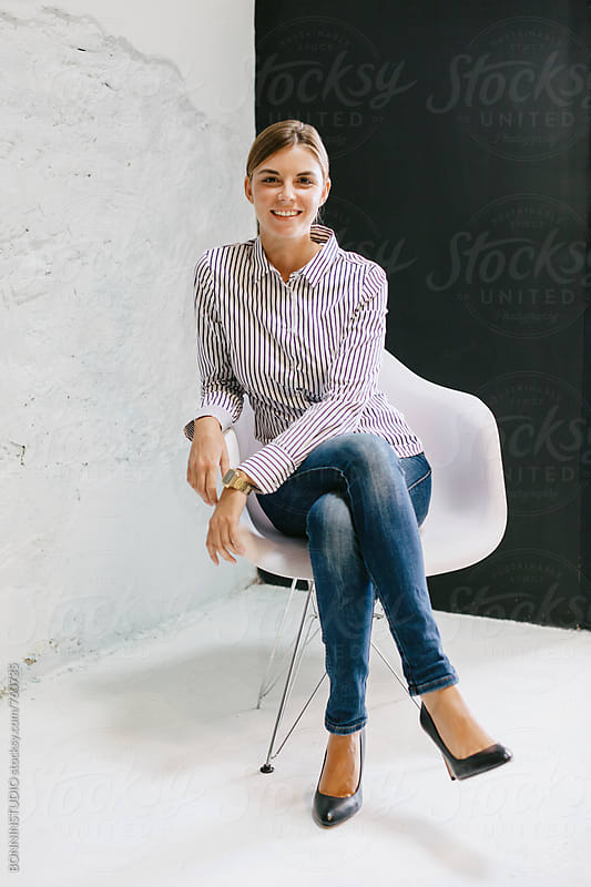 Portrait of a businesswoman taking a break sitting at office. by BONNINSTUDIO for Stocksy United
