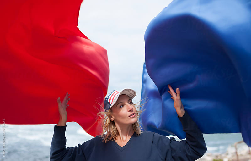 Woman with American Hat and Flag by HEX. for Stocksy United