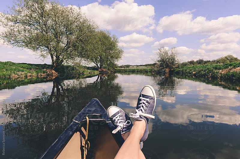 Summer lazing in a canoe by Rebecca Spencer for Stocksy United