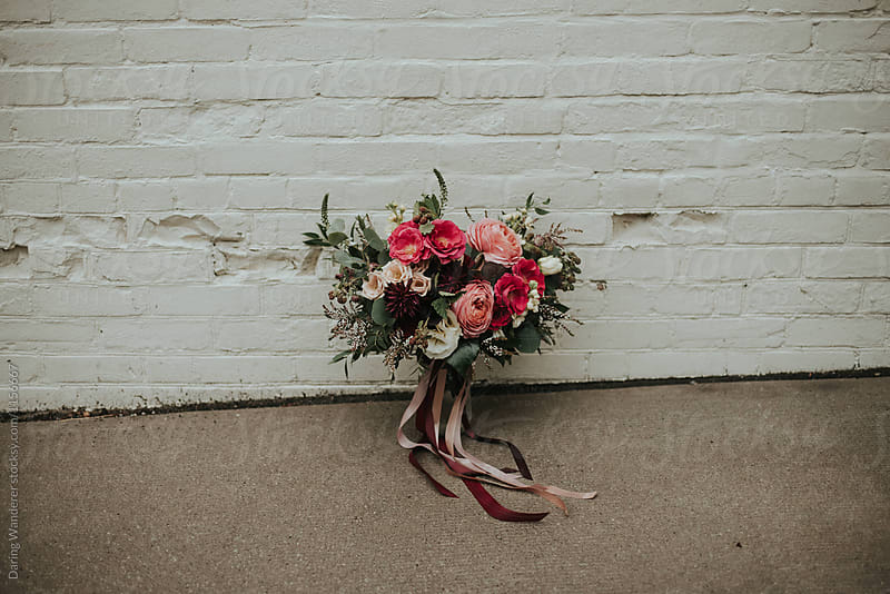 A romantic pink and fuschia summer and fall inspired wedding bouquet