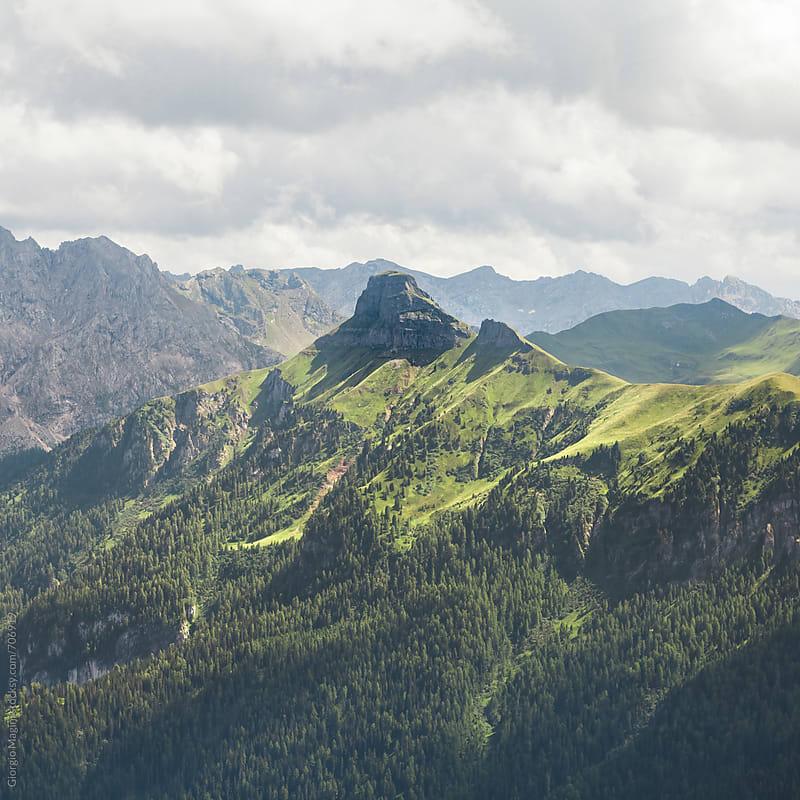 Rocky Peak Over the Valley in the Italian Alps by Giorgio Magini for Stocksy United
