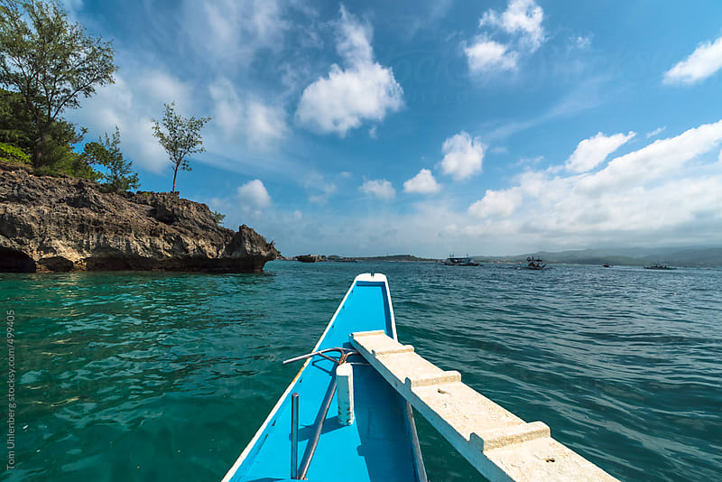Exploring the Shores of Boracay on a Traditional Filipino Boat by Tom Uhlenberg for Stocksy United