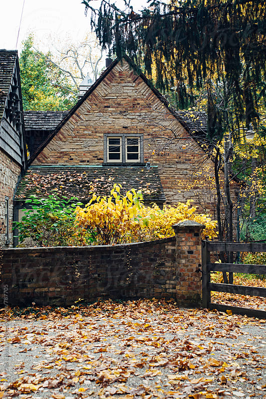 Stone house and fence in the fall by Gabriel (Gabi) Bucataru for Stocksy United